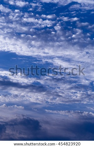 Blue summer sky with light white clouds.