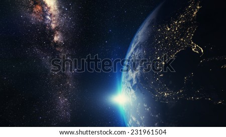 blue sunset, view of earth from space with milky way galaxy - stock photo
