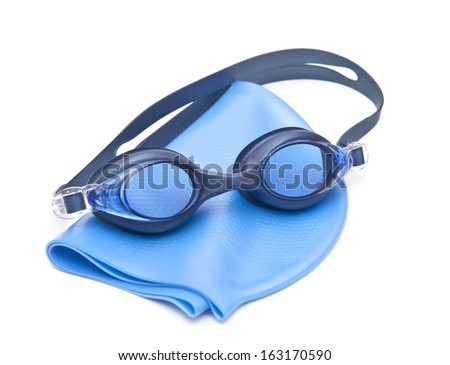 Blue swimming cap and goggles - stock photo