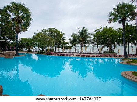 blue swimming pool at hotel.