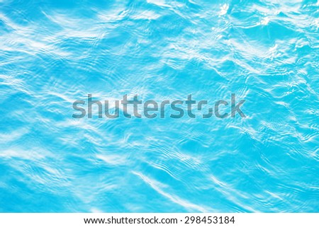 Blue swimming pool rippled water detail - stock photo