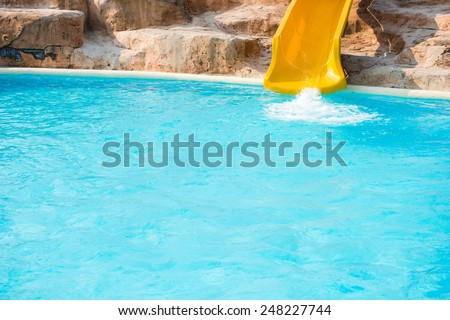 Blue swimming pool with waterslide