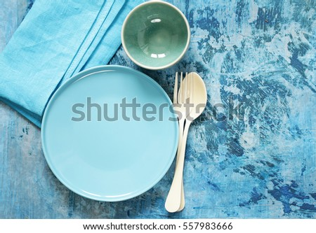 blue table setting - plates cutlery and bowl & Blue Table Setting Plates Cutlery Bowl Stock Photo (Edit Now ...