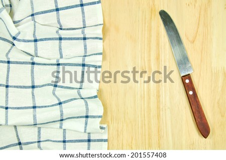 blue tablecloth and knife - stock photo
