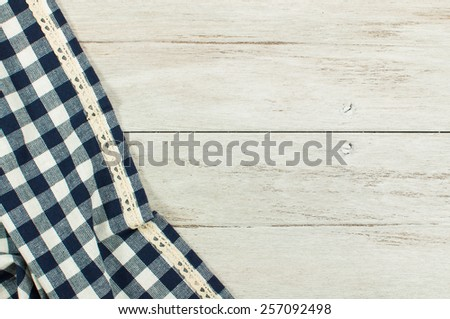Blue tablecloth on white wooden table. - stock photo