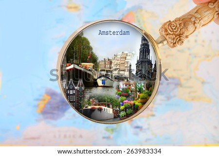 Blue tack on map of Europe with magnifying glass looking in on Amsterdam, Netherlands - stock photo