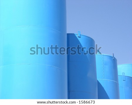 Blue tanks hold agricultural chemicals