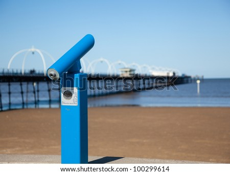 Blue Telescope with sea and pier in Southport England - stock photo