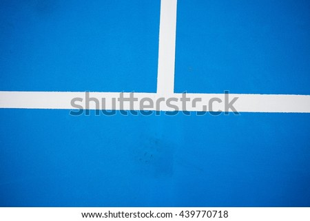 Blue tennis court surface, sport background.