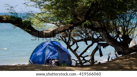 Blue tent at Wailalea Beach, Big Island, Hawaii - stock photo