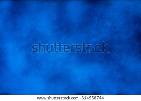 Blue texture background with bright center spotlight - stock photo