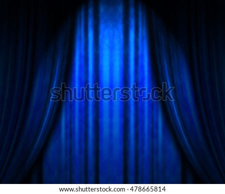 blue theater curtain with soft lighting