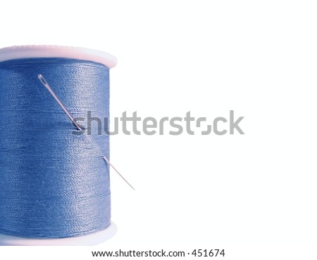 Blue thread and needle isolated on white - stock photo