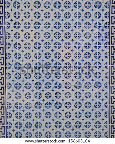 Blue tile in a facade of a building in Lisbon, Portugal - stock photo