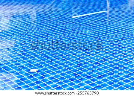 Blue tile pool with water background - stock photo