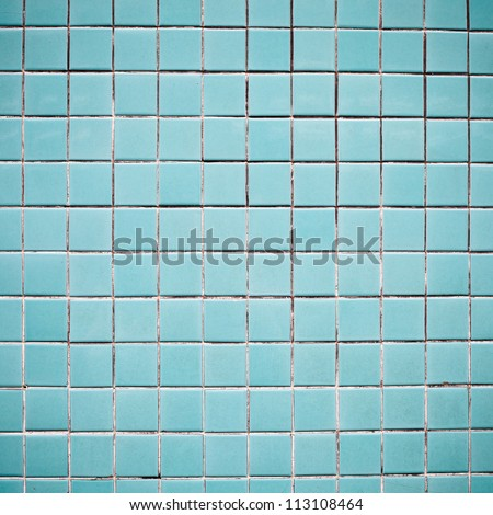Blue tiles on a wall as a background image - stock photo