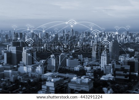 blue tone city scape and wifi and network connection concept - stock photo
