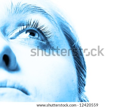 Blue tone face close-up with eye looking up. Shallow DOF. - stock photo