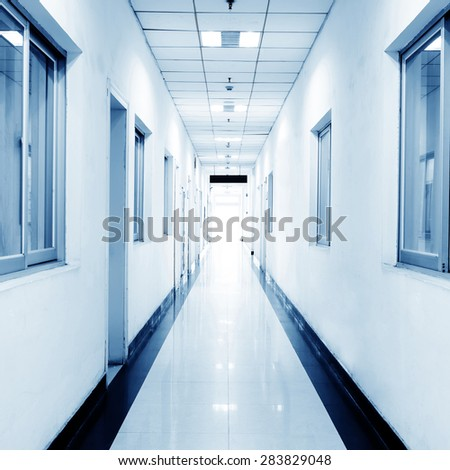 blue tone of long corridor in hospital. - stock photo