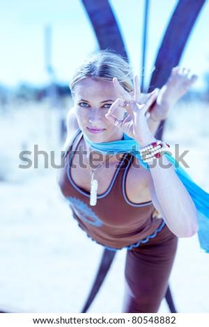 self determined woman yoga posture astavakrasana stock