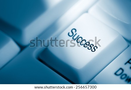 Blue toned concept image with success word on computer keyboard - stock photo