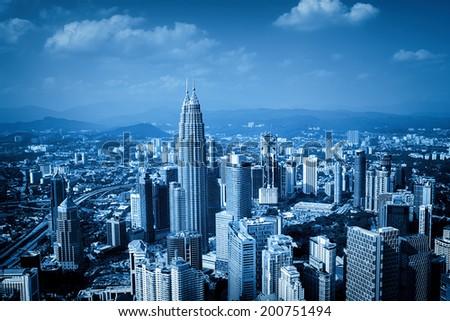 Blue toned image of Kuala Lumpur skyline. (Malaysia) - stock photo
