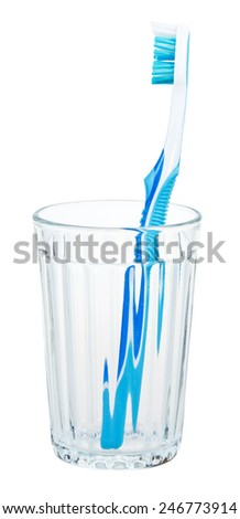 blue toothbrush in glass isolated on white background