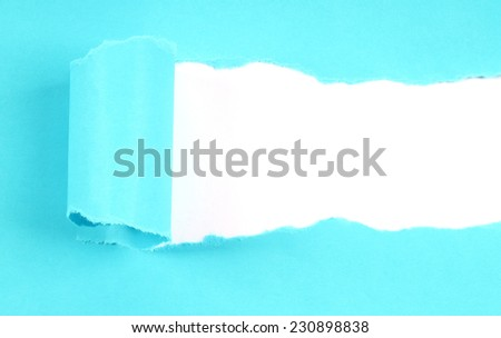 Blue tore paper with copy space close-up - stock photo