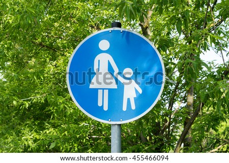 blue Traffic sign with pedestrians - stock photo