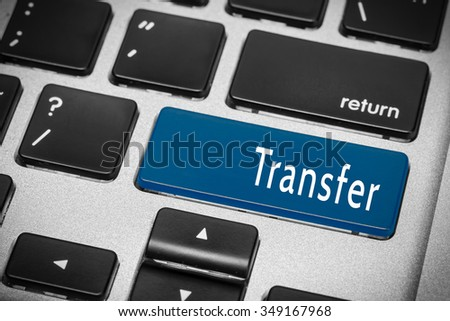 Blue transfer button on the keyboard - stock photo