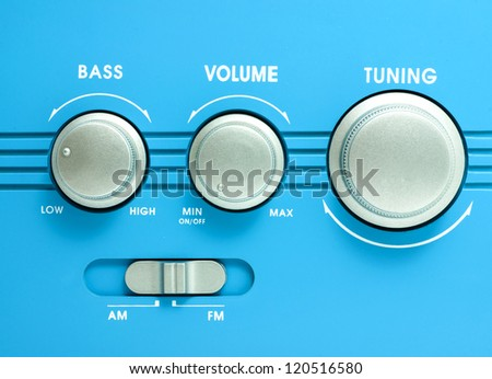 Blue transistor radio button ,tuning, volume, bass equalizer - stock photo