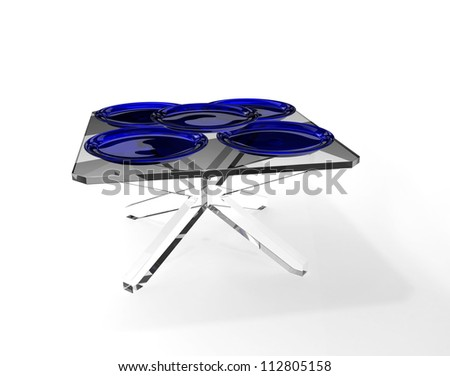 Blue transparency plates on glass table - stock photo