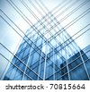 blue transparent glass wall of business center - stock photo