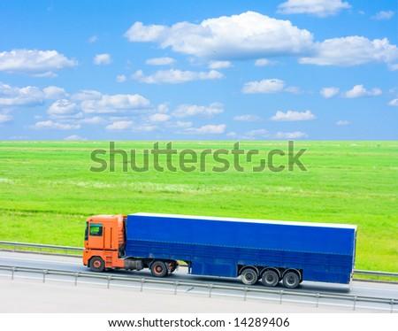 blue truck - green field - stock photo