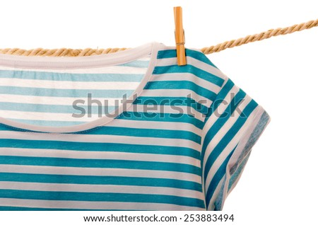blue tshirt hanging on a rope clothesline isolated on white - stock photo