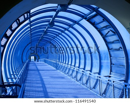 blue tunnel from metal and glass