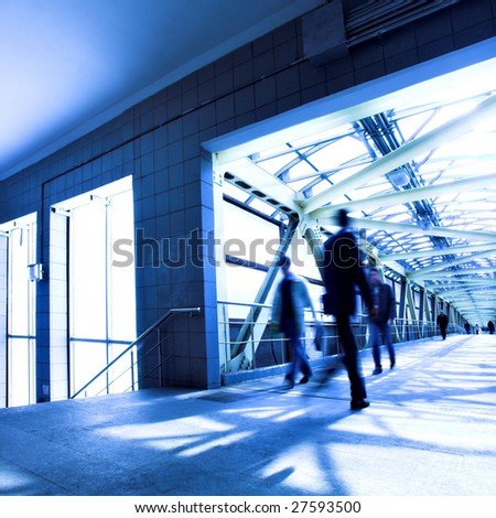Blue tunnel, people mooving - stock photo