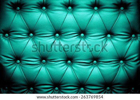 Blue turquoise leather texture background with buttoned pattern - stock photo