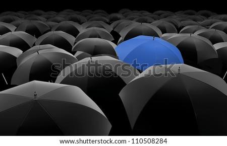blue umbrella among black umbrellas - stock photo