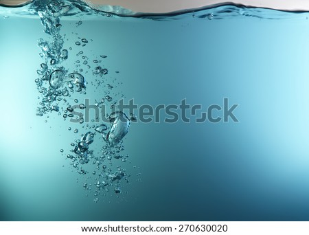 Blue underwater surface and air bubbles - stock photo