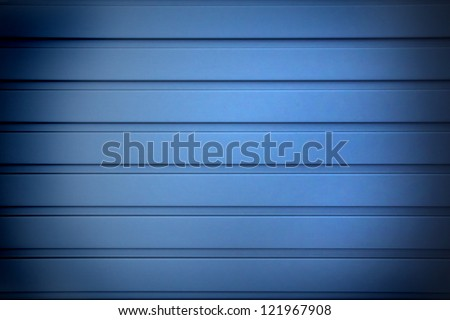 blue undulated metal sheet, background design with dark edges - stock photo