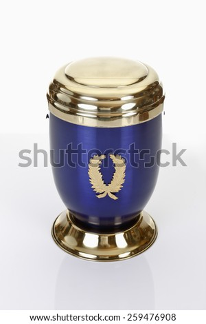 Blue urn with golden wreath on white background - stock photo