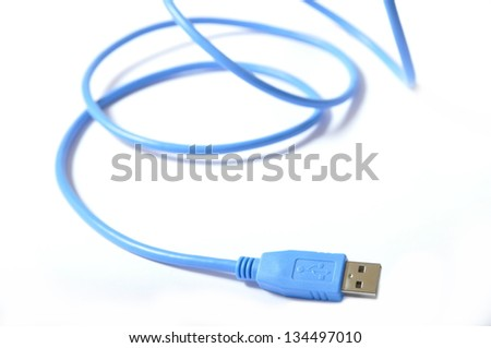 Blue USB cable on white background - stock photo