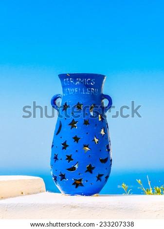 Blue vase decoration on the terrace of Fira, Santorini - stock photo