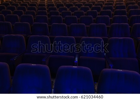 blue velvet seats for spectators in the theater or cinema