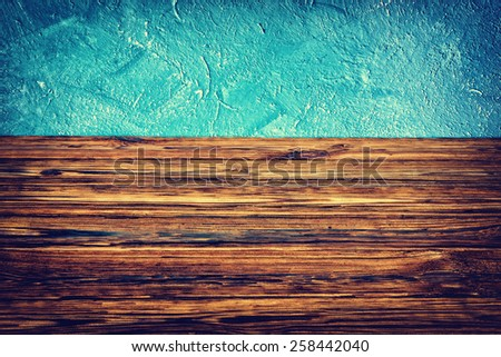 Blue wall and wooden boards background - stock photo