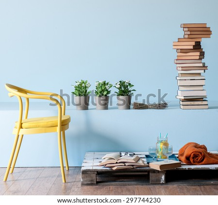blue wall interior style with yellow chair  - stock photo