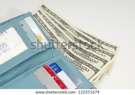 Blue wallet with dollars isolated over white background