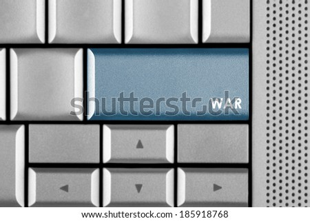 Blue WAR key on a computer keyboard with clipping path around the WAR key - stock photo