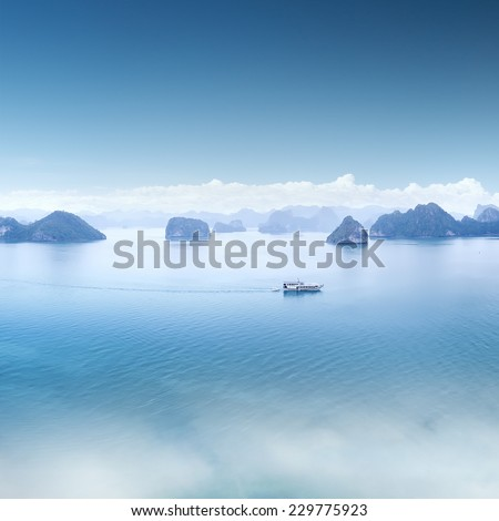 Blue water and sky aerial view panorama of Halong Bay in Vietnam. Scenic background landscape